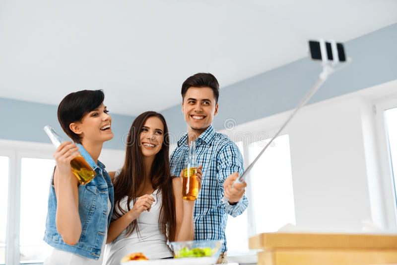 Dinner Party. Friends Having Fun, Taking Selfie. Holiday Celebration. Friendship royalty free stock images