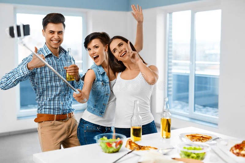 Dinner Party. Friends Having Fun, Taking Selfie. Holiday Celebration. Friendship royalty free stock photography