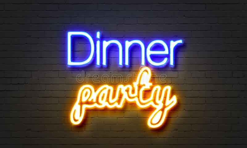 Dinner party neon sign on brick wall background. stock image