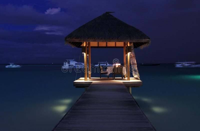 Dinner pavilion over the sea, Maldives stock photography