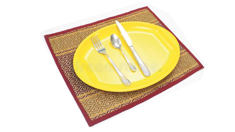 Dinner plate setting. Yellow empty dinner plate setting on cloth stock photography