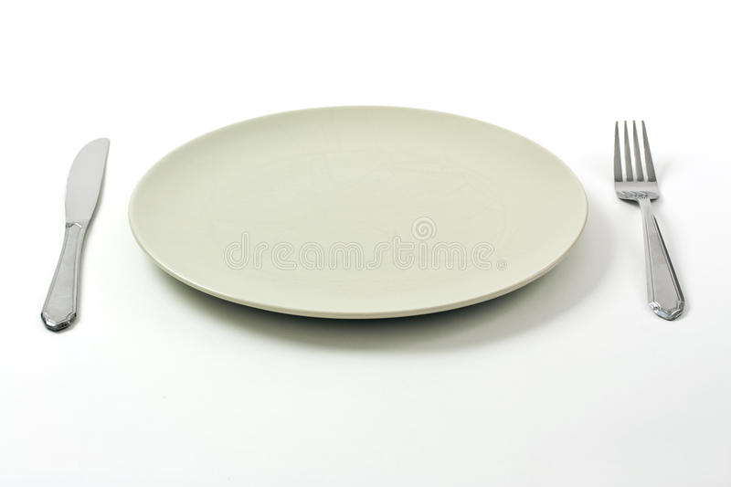 Dinner plate and silverware royalty free stock images