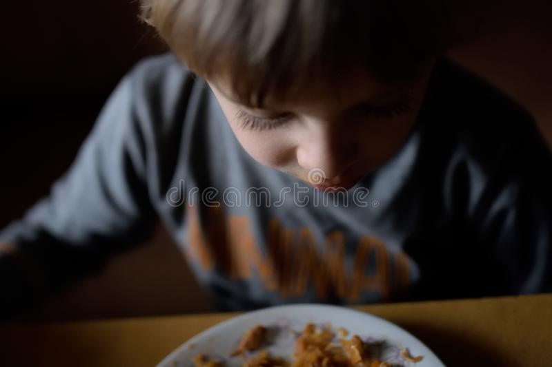 Dinner in a poor family. Food for a poor child. royalty free stock photos