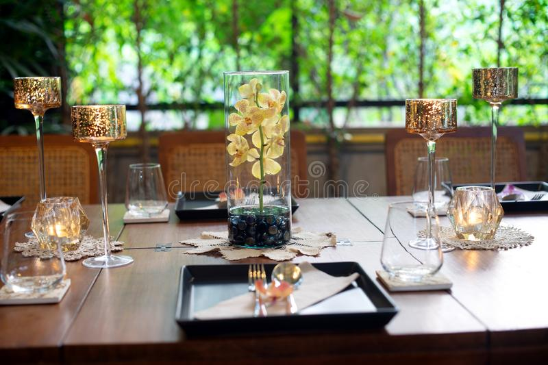 Dinner set on the wood table with long wine glass royalty free stock photo