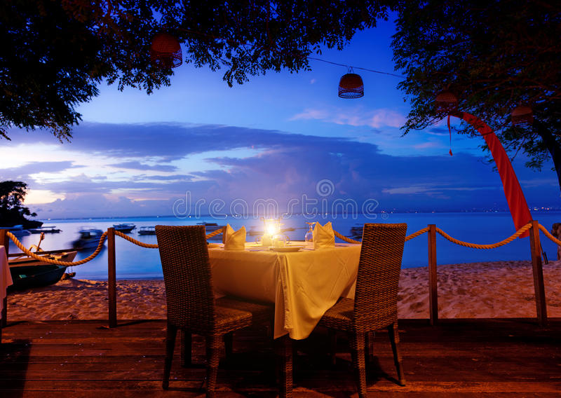 Dinner on sunset. At beach in Bali, Indonesia royalty free stock photography
