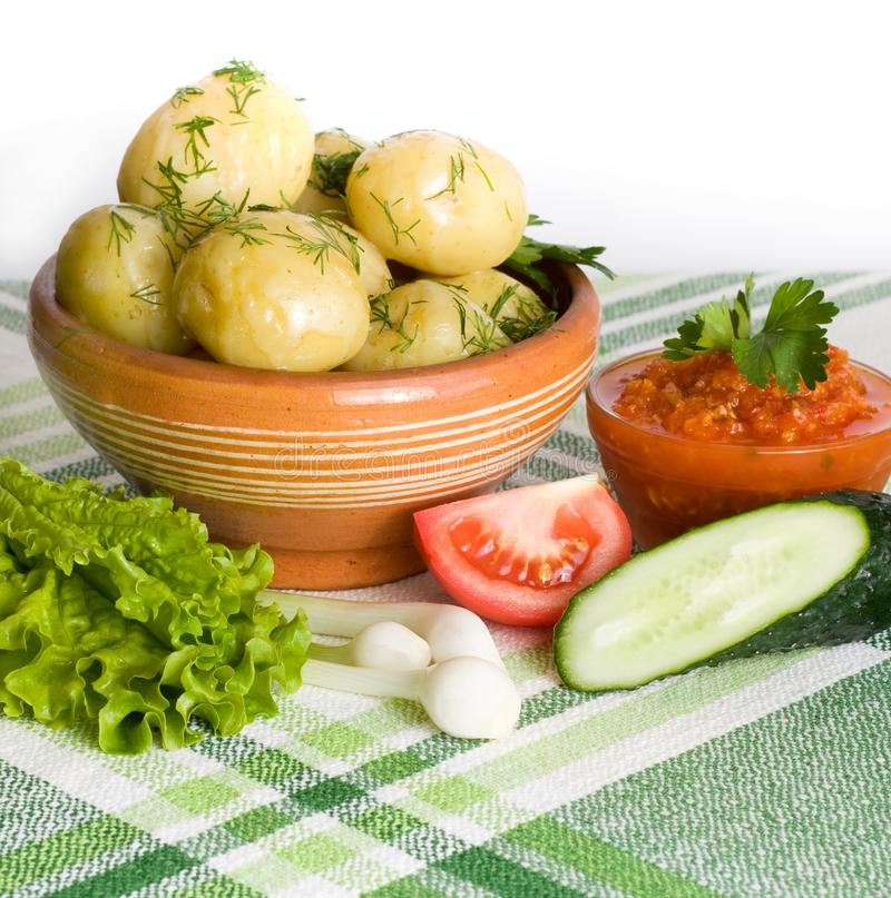 Dinner on table. Boiled potatoes and other vegetables on the table stock images
