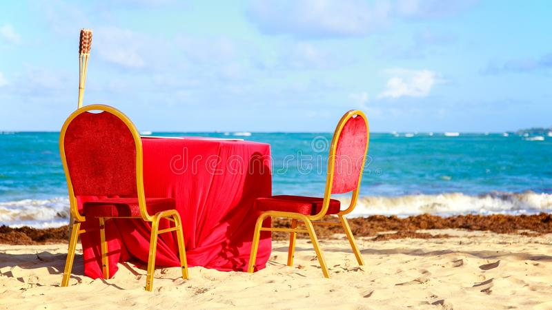 Dinner table on the beach royalty free stock images
