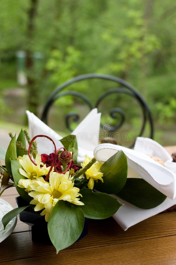 Dinner table in the garden royalty free stock image