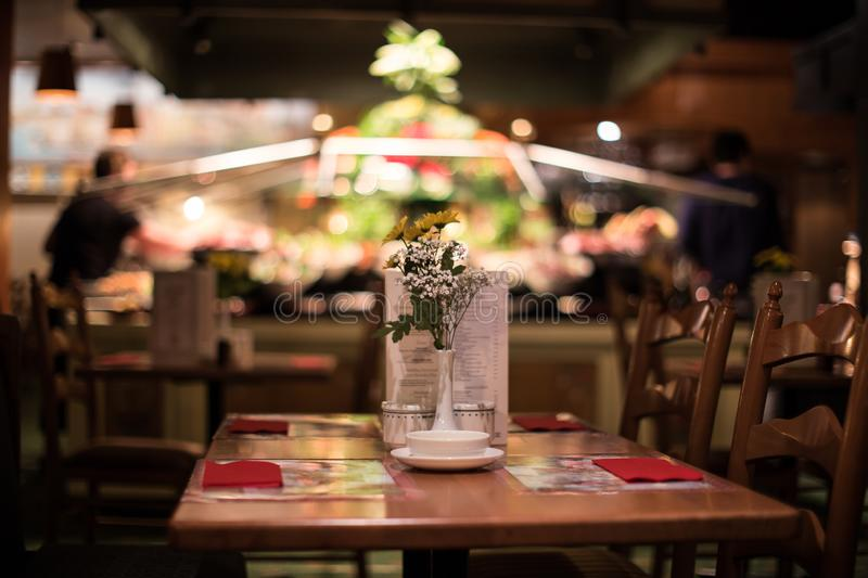 Dinner Table at a Rustic and Fancy Restaurant. Romantic setting for dinner at a Perth restaurant. The table seats four with a flower vase in the middle of it stock photo