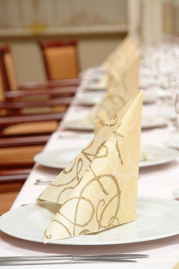 Dinner table setting stock image
