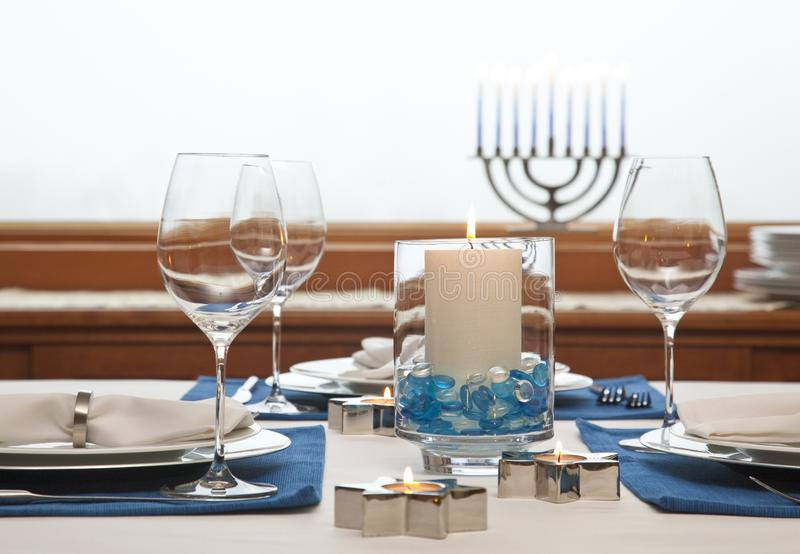 Dinner table setting decorated for Hanukkah. Traditional Jewish holidays home celebrations decor. Dinner table setting decorated for Hanukkah Chanukah stock image