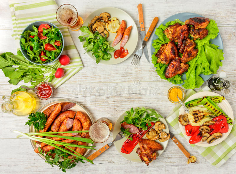 Dinner table with variety food stock image