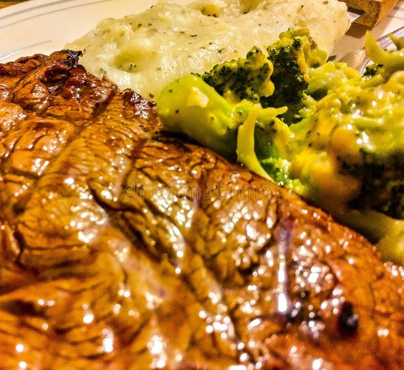 Dinner Time!. Filet Mignon mashed potatoes broccoli eat steak restaurant family gathering meal royalty free stock photos