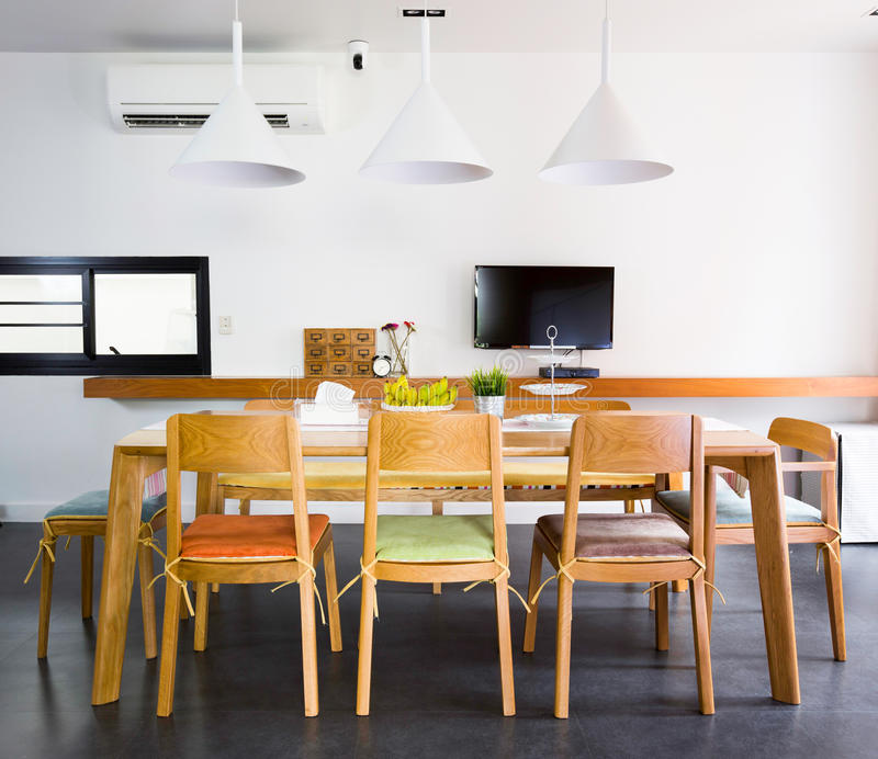 Dinning Room. Contemporary dinning room with wooden tables and chars royalty free stock image
