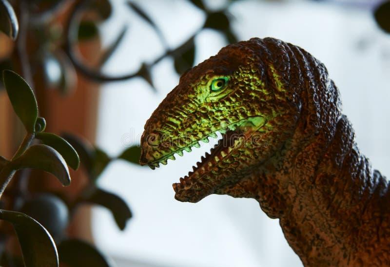 Dinosaur. Vicious Dinosaur on trees background royalty free stock image