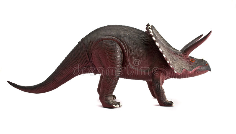 Dinosaur. Statuette close-up isolated on a white background royalty free stock image