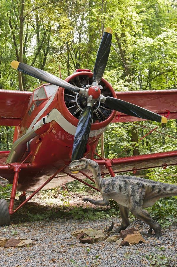 Dinosaur and biplane royalty free stock photos