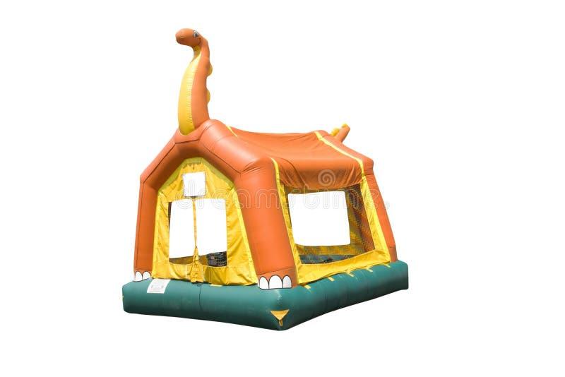 Dinosaur bounce house. Colorful dinosaur themed bounce house on white stock image