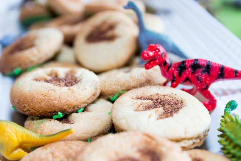 Dinosaur cookies. Dinosaur theme kids birthday party cookies royalty free stock image