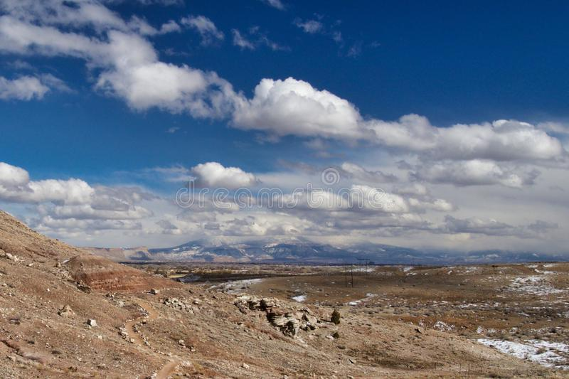 Dinosaur Hill Trail in Winter. Far view of Grand Mesa. Dinosaur Hill trail near Fruita Colorado loops past geological and paleontological points of interest royalty free stock photo