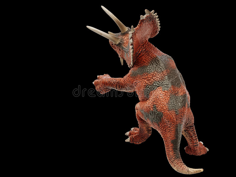 Dinosaur. Isolated dinosaur in black background royalty free stock images