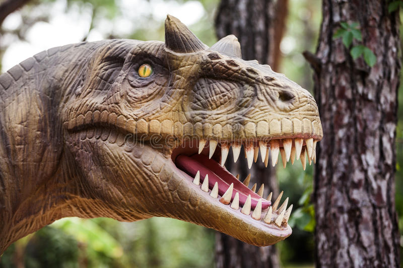 Dinosaur showing his toothy mouth. Prehistoric era dinosaur walking forest showing his toothy mouth royalty free stock photography