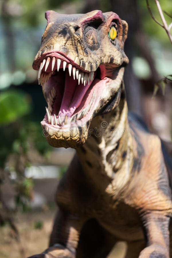 Dinosaur showing his toothy mouth. Prehistoric era dinosaur walking forest showing his toothy mouth royalty free stock photos