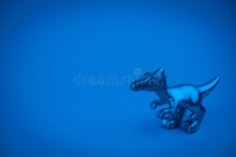 Dinosaur statuette trendy minimal art card. Dinosaur statuette  with copy space trendy minimal art card stock images