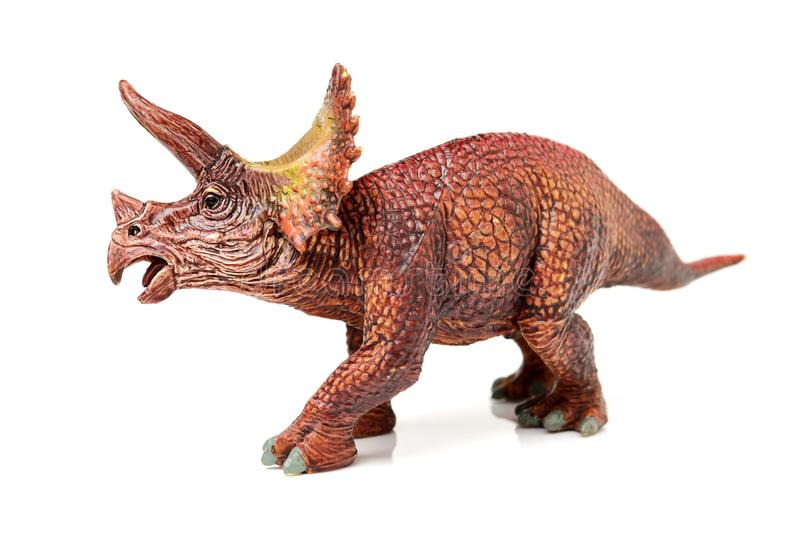 Dinosaur statuette. Toys on the white background stock image