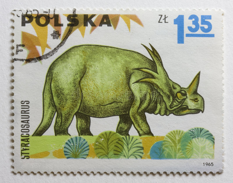 Dinosaur (styracosaurus) on vintage post stamp. Dinosaur (styracosaurus) on vintage (1965), canceled post stamp from Poland royalty free stock photography
