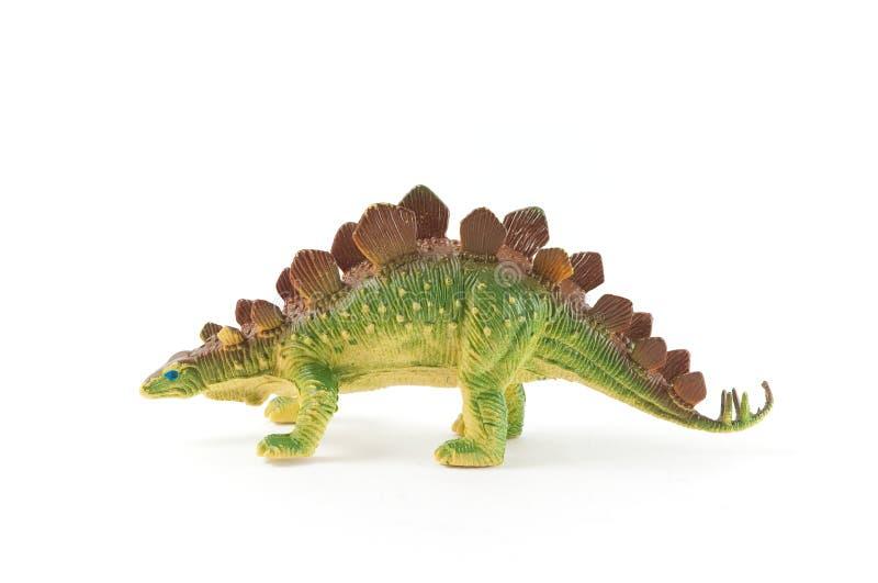 Dinosaur toy. Green dinosaur toy isolated on white background stock photo