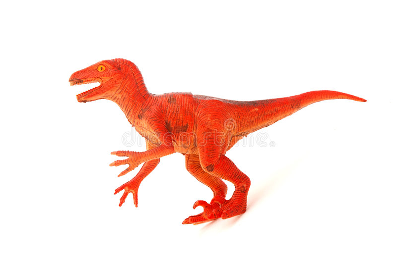 Dinosaur toy. An orange used dinosaur toy for kids to play with. Image isolated on white studio background royalty free stock image