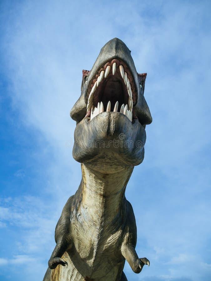 Dinosaur. Tyrannosaurus Rex on blue sky background vertical style royalty free stock photo