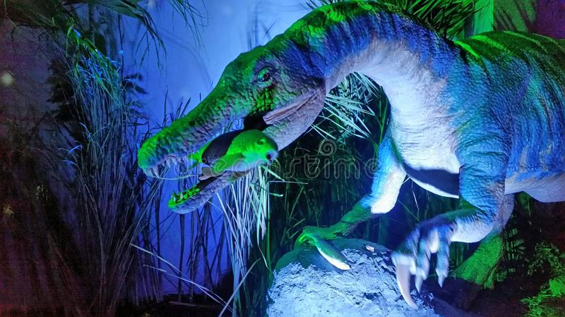 Dinosaur. Who eat a fish stock photos