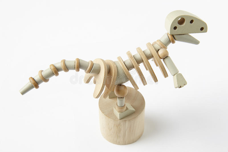 Dinosaur wooden articulated toy isolated on white. Horizontal royalty free stock photo