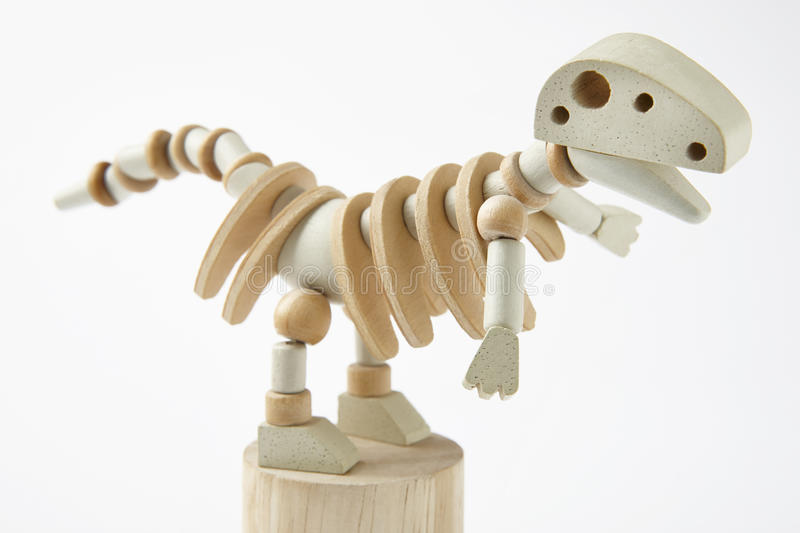 Dinosaur wooden articulated toy isolated on white. Horizontal royalty free stock photos