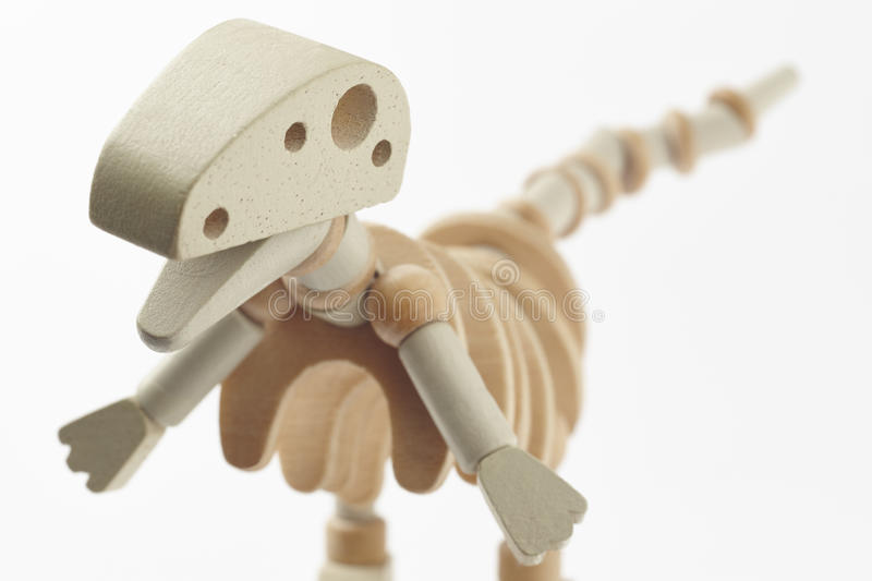 Dinosaur wooden articulated toy isolated on white. Horizontal stock image