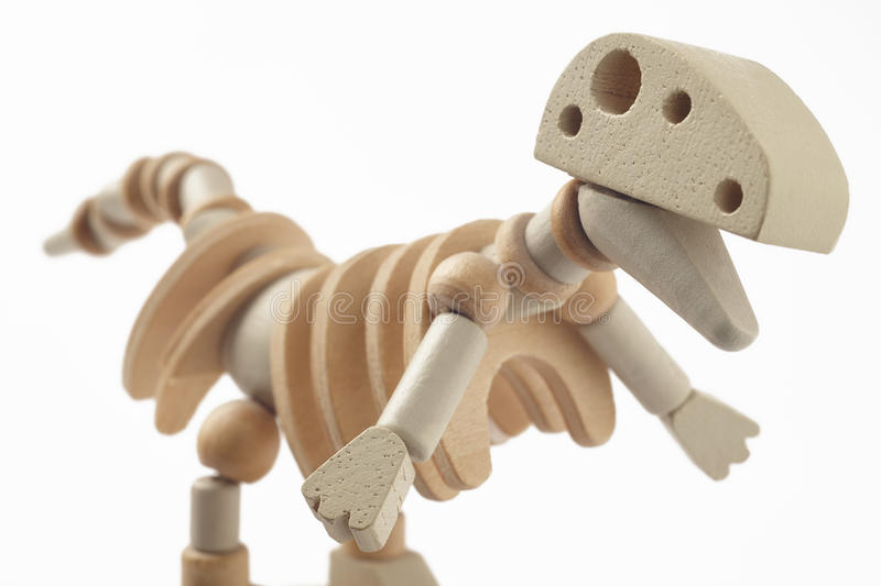 Dinosaur wooden articulated toy isolated on white. Horizontal royalty free stock images
