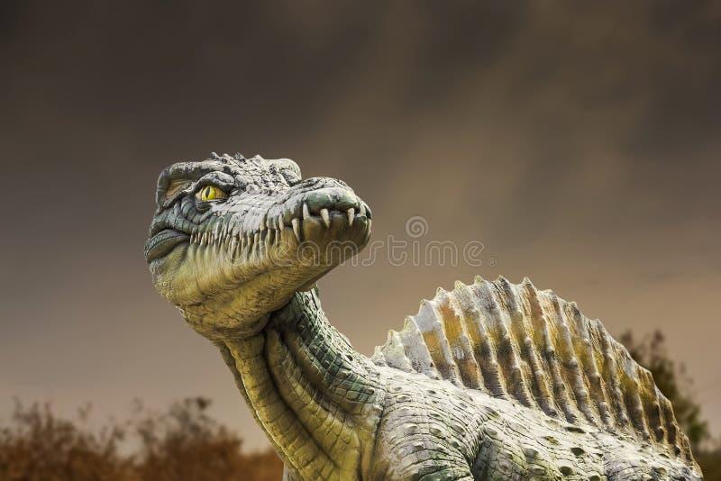 Dinosaure carnivore de côté photographie stock libre de droits