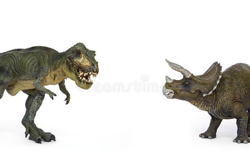 Dinosaurietyrannosarie och Triceratops arkivbild