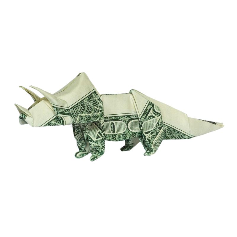 Dinosaurio del Triceratops de la papiroflexia del dinero doblado con el un dólar real Bill Isolated imagenes de archivo