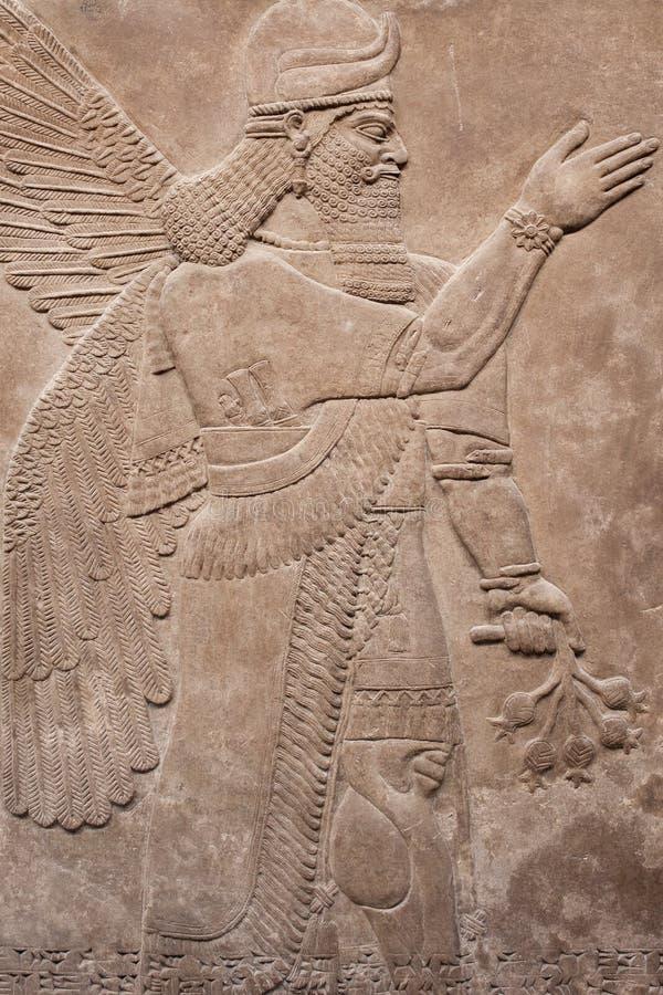 Dio alato assyrian antico immagini stock libere da diritti