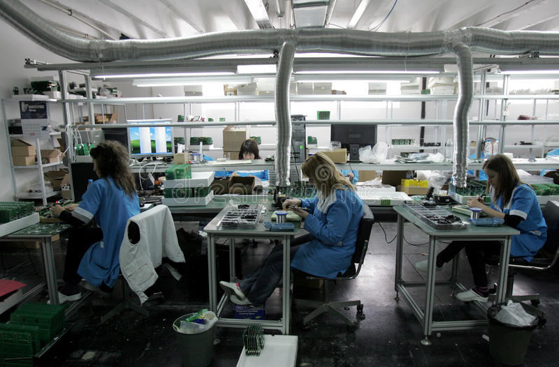 Diode Factory Workers. Workers assembling electronics in diode factory, Feb 25, 2011, Botevgrad, Bulgaria royalty free stock images