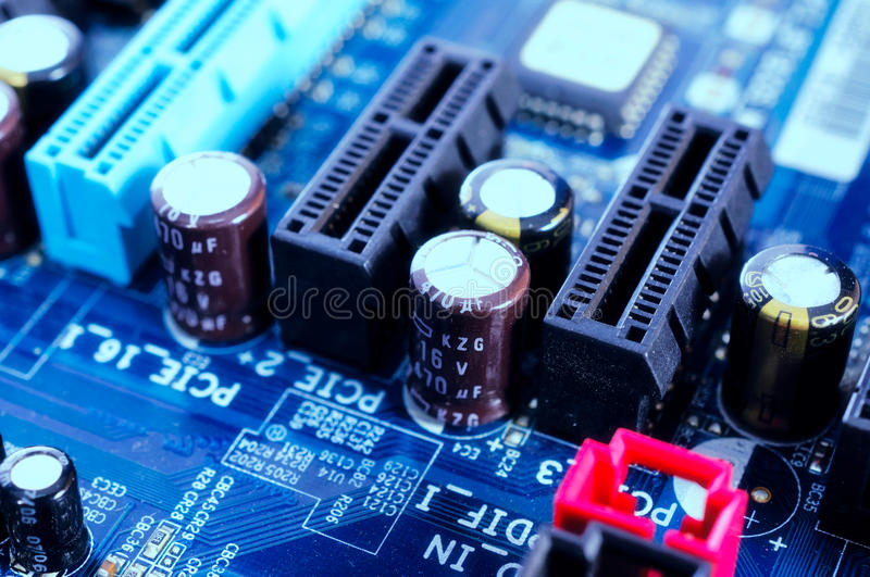 Diodes on board. Close uo to diodes on the motherboard stock image