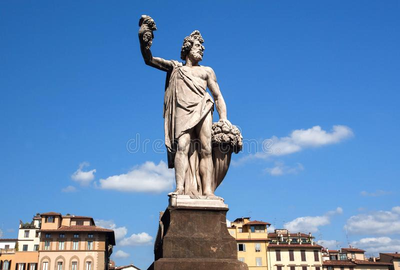 Dionysus sculpture standing on street of Florence. The god of the grape-harvest, winemaking and wine of Firenze, Italy. Dionysus sculpture standing on street of royalty free stock images