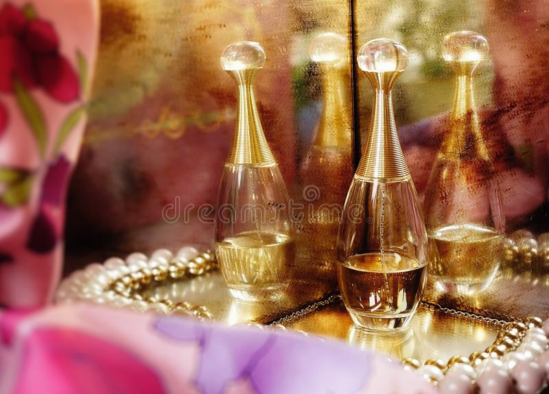 Dior perfume sprayer glass mirror jewelry luxury gold pearl royalty free stock photos