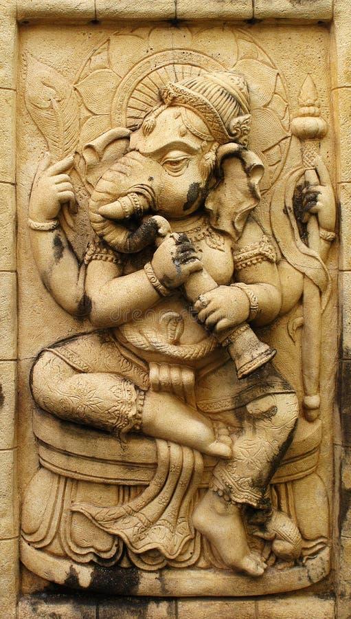 Dios hindú de Ganesh hecho de piedra imagenes de archivo