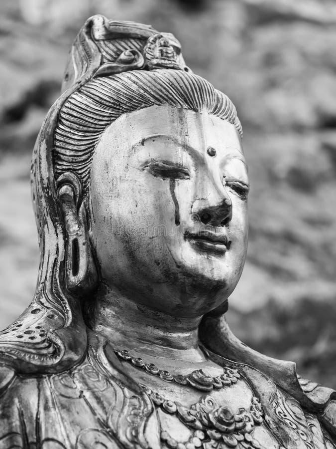 Diosa gritadora monocromática de la estatua de la misericordia (Quan Yin, Kuan Yim, imágenes de archivo libres de regalías