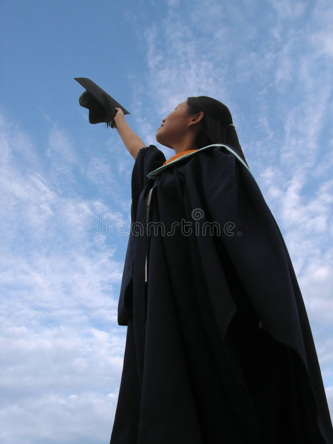 Diplômée réussie de femelle   photos stock