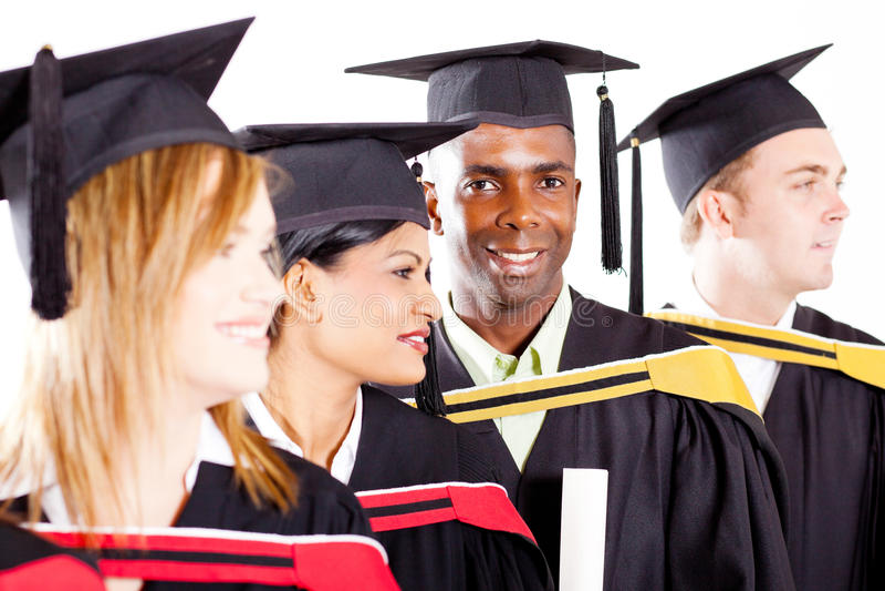 Diplômés à la graduation images libres de droits